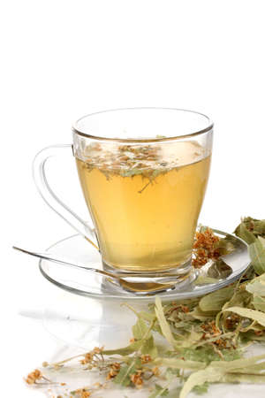 Glass cup of tea with linden isolated on white Stock Photo - 17111856