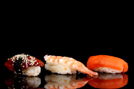 delicious sushi isolated on black photo
