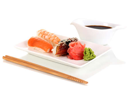 delicious sushi served on plate isolated on white photo