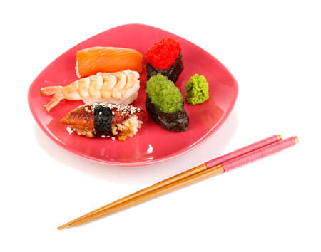 delicious sushi served on red plate isolated on white photo