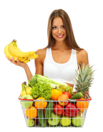 beautiful young woman with fruits and vegetables in shopping basket, isolated on white Stock Photo - 17281923