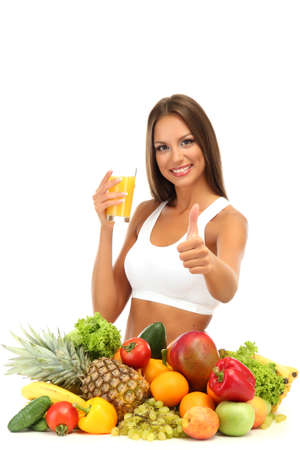beautiful young woman with fruits and vegetables and glass of juice, isolated on white photo