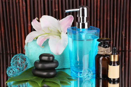 Beautiful spa setting on bamboo background with reflection Stock Photo - 17117960