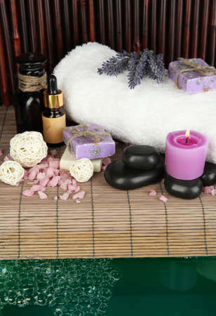 Beautiful spa setting near pool on bamboo background photo