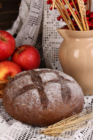 Rye bread on autumn composition background photo