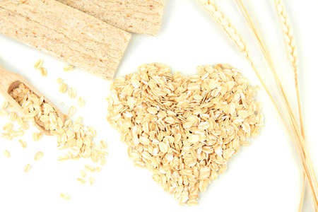Heart shape made from oat flakes with oat biscuits and ears isolated on white Stock Photo - 17116647