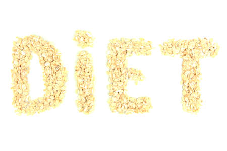 the word diet made from oat flakes isolated on white photo