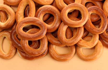 tasty bagels, on beige background photo