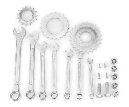 Machine gear, metal cogwheels, nuts and bolts isolated on white Stock Photo - 17111641