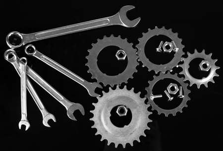 Machine gear, metal cogwheels, nuts and bolts isolated on black Stock Photo - 17117047