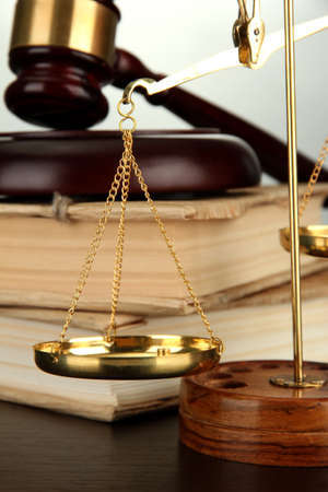 Golden scales of justice, gavel and books on grey background Stock Photo - 17117199