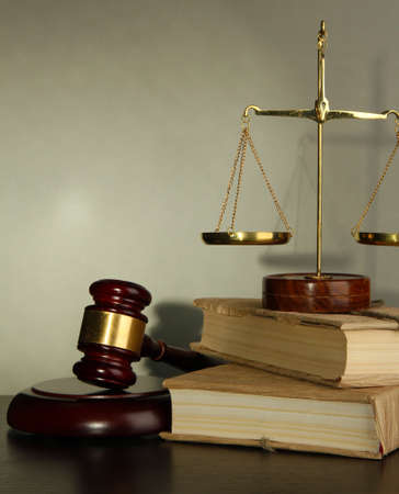 Golden scales of justice, gavel and books on grey background Stock Photo - 17116619