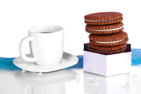 nutritiously: Chocolate cookies with creamy layer and cup of coffe on purple background Stock Photo