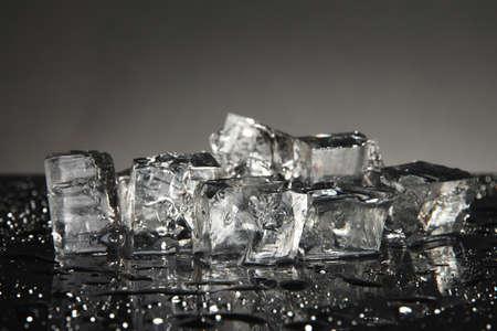 Ice cubes isolated on black photo