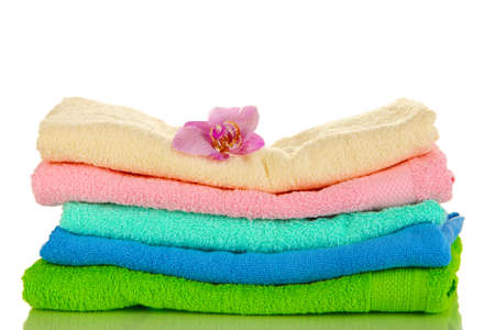 Stack of towels with fragrant flower isolated on white Stock Photo - 17117201
