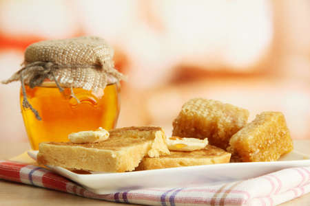 White bread toastwith honey on plate in cafe photo