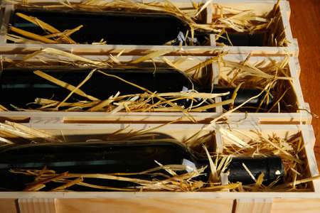 cabarnet: Wooden case with wine bottles close up