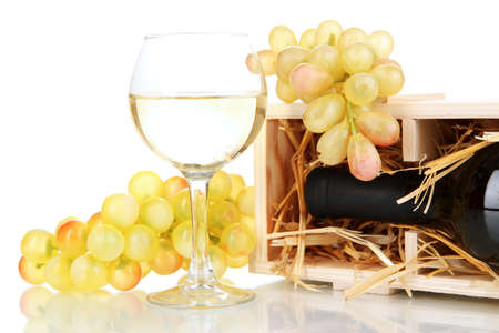 Wooden case with wine bottle, barrel, wineglass and grape isolated on white Stock Photo - 17116611