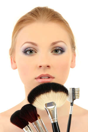 portrait of beautiful woman with make-up brushes, isolated on white photo