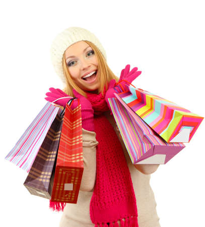 Attractive young woman woman with lot of shopping bags, isolated on white Stock Photo - 17281509