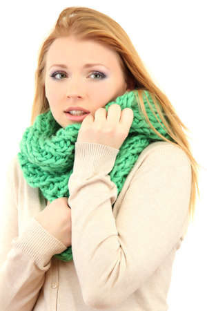 Young beautiful woman wearing winter clothing on cold wind, isolated on white photo