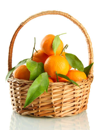 Ripe sweet tangerine with leaves in basket, isolated on white Stock Photo - 17112234