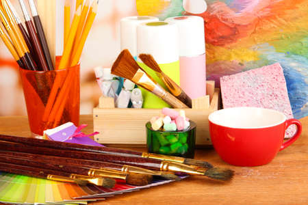 Artistic equipment: paint, brushes and art palette photo