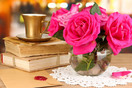Beautiful pink roses in vase on wooden table on room background Stock Photo - 17117093