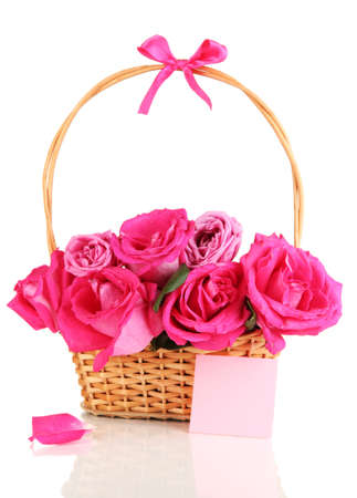 Beautiful pink roses in basket isolated on white Stock Photo - 17111725