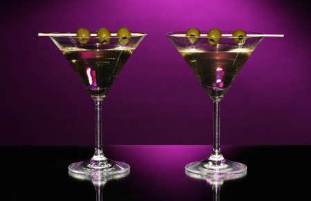 Martini glasses on dark background photo
