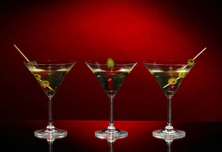 Martini glasses on dark background photo