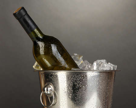 Bottle of wine in ice bucket on black background Stock Photo - 17117338