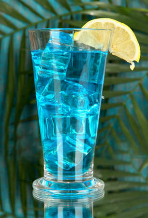 Blue Lagoon cocktail on  tropical background photo