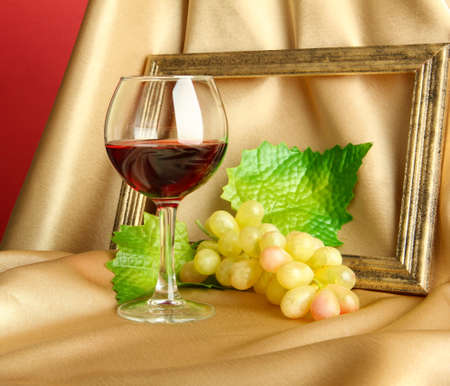 composition of frame,wine and grapes on bright background photo