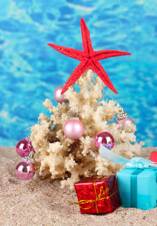 Conceptual photo: Celebrating Christmas at beach photo