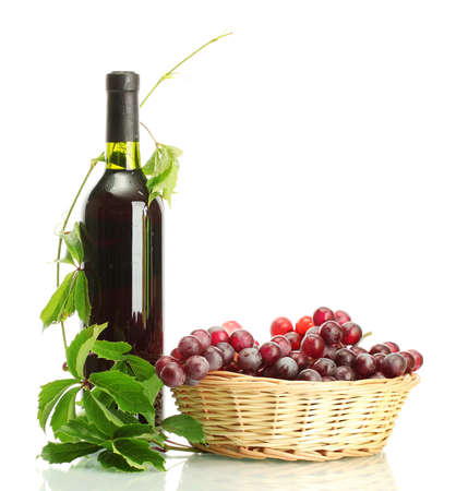 bottle of wine with grapes isolated on white photo