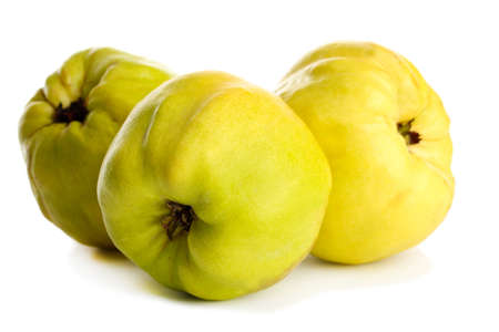 sweet quinces, isolated on white photo