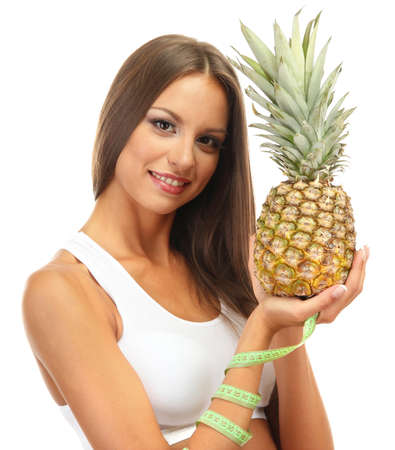 beautiful young woman with pineapple and measure tape, isolated on white photo