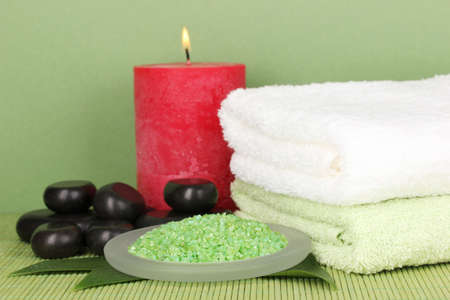beautiful spa setting on green background photo