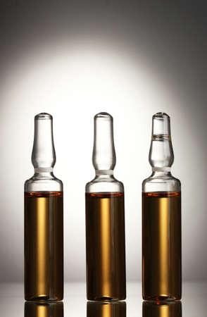 ampules: medical ampules on grey background Stock Photo