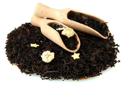 aromatic black dry tea with flowers, isolated on white photo