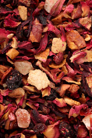 aromatic dry tea with fruits and petals, close up photo