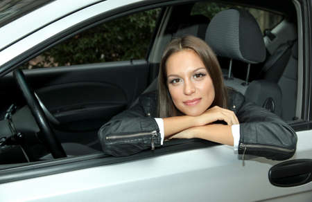 beautiful young woman in car photo