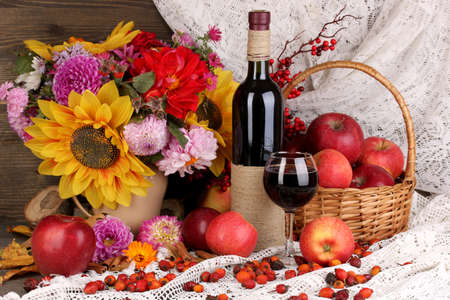 Colorful autumn still life with apples and and wine close-up photo