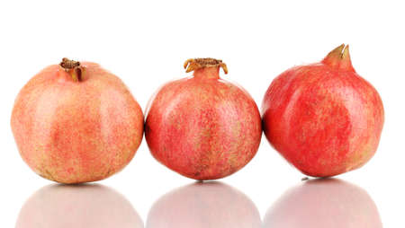 Ripe pomegranates isolated on white photo