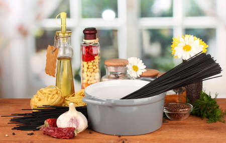 spaghetti in pan on wooden table on bright background Stock Photo - 17143593