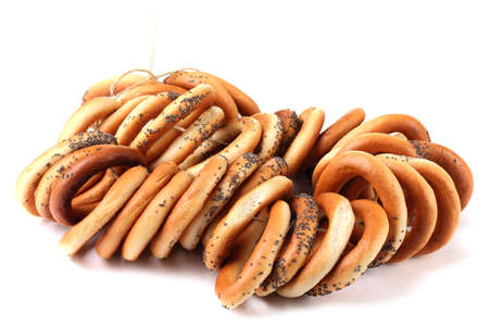 tasty bagels on rope, isolated on white photo