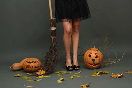 Halloween background with pretty female legs photo