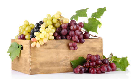 assortment of ripe sweet grapes in wooden crate, isolated on white Stock Photo - 17140678