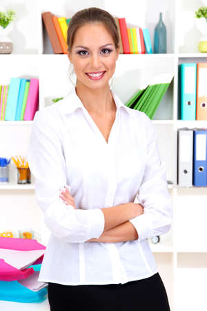 female teacher: young business woman at office